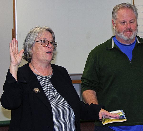 Bridgit Burke, takes her oath of office
