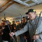 Ron Bernhardpasses a gun to another member of Knox's Helderberg Rod and Gun Club