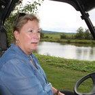 Donna Abbruzzese, seated in a golf cart