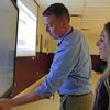 Bill Dergosits runs his fingers over a Promethean board